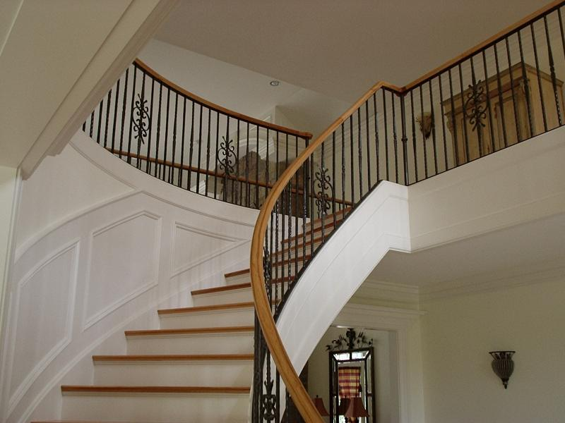 Curved stairs metal pickets gallery roes stair company for Curved staircases